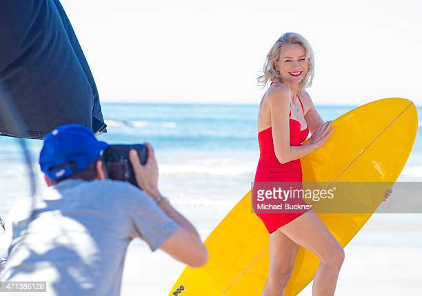 Behind the scenes Naomi Watts prepares to strike a surf pose as she helps British Airways celebrate 80 years of flying to Australia with a vintage...