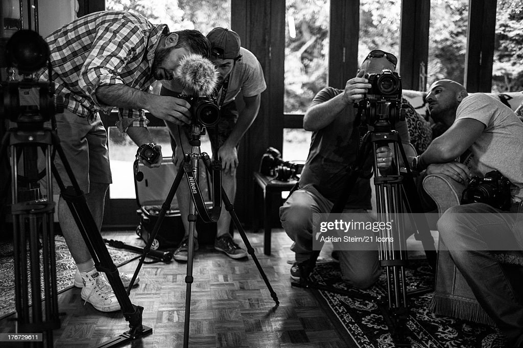 Behind the scenes of Adrian Steirn's portrait shoot of Sophia Williams De Bruyn, 'In Prayer and Protest', (L-R) Richard Gregory, Daniel Snyders, Damon Hyland and Adrian Steirn prepare the cameras for the interview with Sophia Williams de Bruyn on location at her home in Johannesburg, on March 4, 2012 as part of photographer and filmmaker Adrian Steirn's 21 Icons South Africa Series. Inspired by Nelson Mandela, 21 Icons is a series of short films and photographic portraits documenting the stories of key figures in South Africa's recent history, including former presidents FW de Klerk and Archbishop Emeritus Desmond Tutu. Proceeds from the syndication of this portrait will be donated to The Sophia De Bruyn and Henry Benny Nato De Bruyn Legacy Foundation.