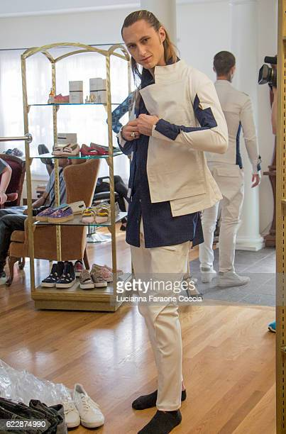 Behind the scenes with model Aaron Mann at 'Front Row' fashion shoot at The Starving Artists Project on November 11 2016 in Los Angeles California