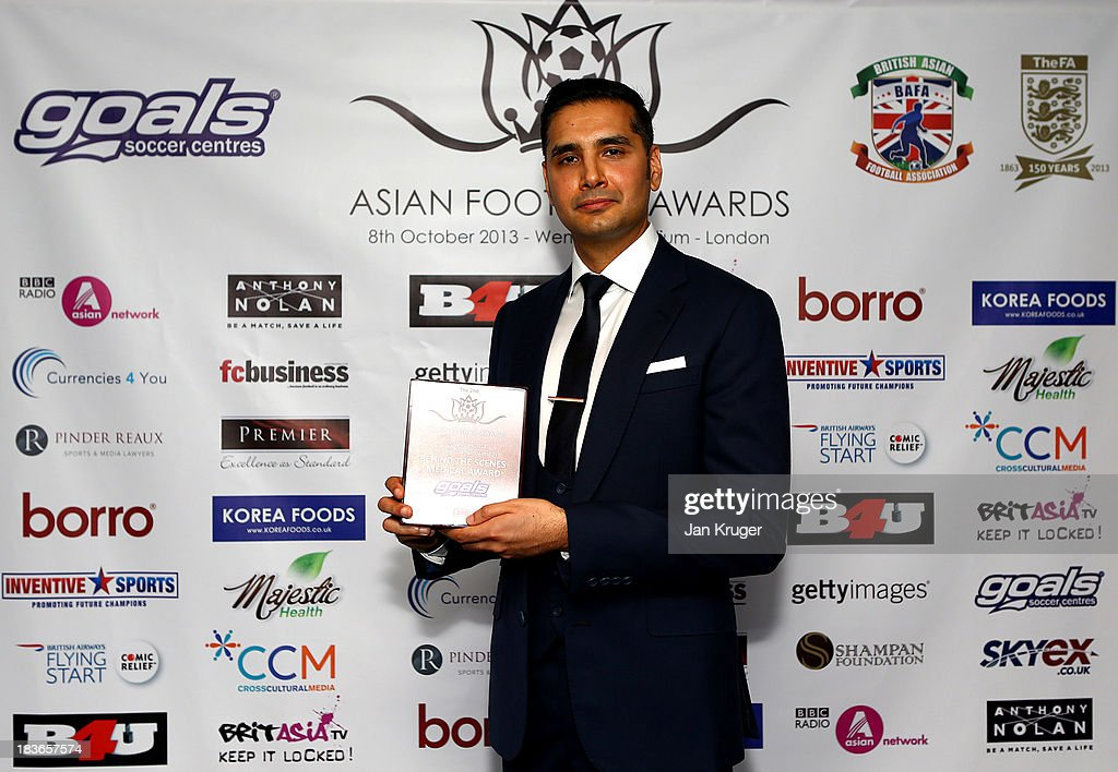 Behind the Scenes-Medical Award winner Shabaaz Mughal poses during the Second Annual Asian Football Awards at Wembley Stadium on October 8, 2013 in London, England.