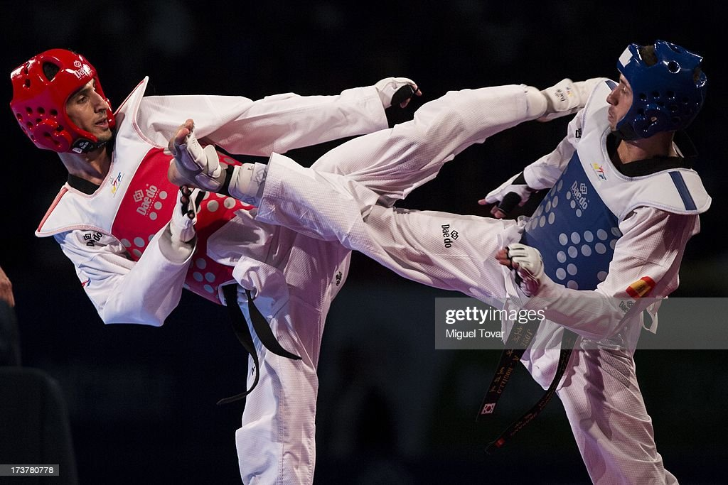 Behnam Asbaghikha of Iran (red) competes with Jose Antonio Rosillo of Spain (blue) during a Men's -68 kg combat of WTF World Taekwondo Championships 2013 at the exhibitions Center on July 17, 2013 in Puebla, Mexico.