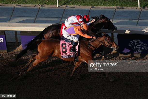 Beholder ridden by jockey Gary Stevens wins in the Longines Breeders' Cup Distaff during day one of the 2016 Breeders' Cup World Championships at...