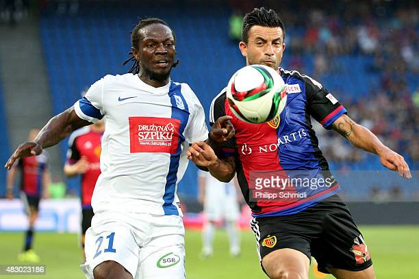 Behrang Safari of FC Basel fights for the ball with Kebba Ceesay of KKS Lech Poznan during the UEFA Champions League third qualifying round 2nd leg...