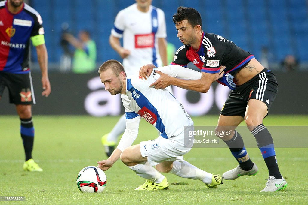 Behrang Safari of FC Basel (R) fights for the ball with <a gi-track='captionPersonalityLinkClicked' href=/galleries/search?phrase=Szymon+Pawlowski&family=editorial&specificpeople=8043042 ng-click='$event.stopPropagation()'>Szymon Pawlowski</a> of KKS Lech Poznan during the UEFA Champions League third qualifying round 2nd leg match between FC Basel 1893 and KKS Lech Poznan at St. Jakob-Park on August 5, 2015 in Basel, Switzerland.