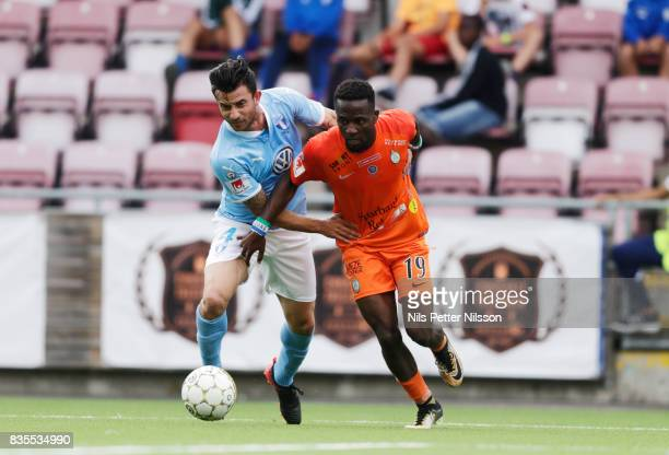Behrang Safari of Malmo FF and Mohammed Buya Turay of Athletic FC Eskilstuna competes for the ball during the Allsvenskan match between Athletic FC...