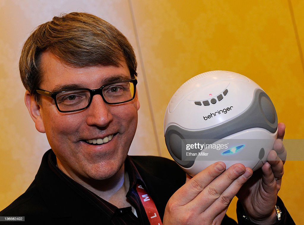 Behringer Vice President of Marketing Communications Mark Wilder displays a Behringer Splash Bluetooth speaker that you can throw in your pool during a press event at The Venetian for the 2012 International Consumer Electronics Show (CES) January 8, 2012 in Las Vegas, Nevada. The Splash comes with a separate dock for music players and will be available in the second quarter of 2012 for USD 99. CES, the world's largest annual consumer technology trade show, runs from January 10-13 and is expected to feature 2,700 exhibitors showing off their latest products and services to about 140,000 attendees.