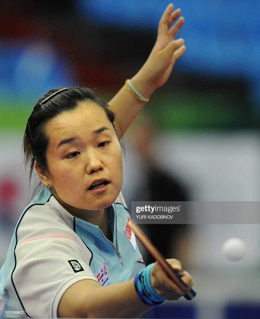 Beibei Sun of Singapore returns a service to Sabine Winter of Germany during the women's semi final at the 2010 World Team Table Tennis Championships in Moscow on May 29, 2010.