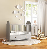 3d Rendering of a Beige and grey nursery baby room with rug