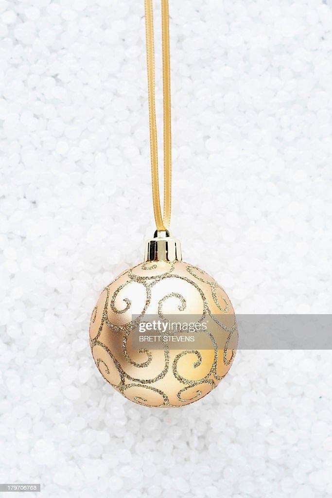Beige bauble with gold swirls