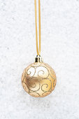 Beige bauble with gold swirls