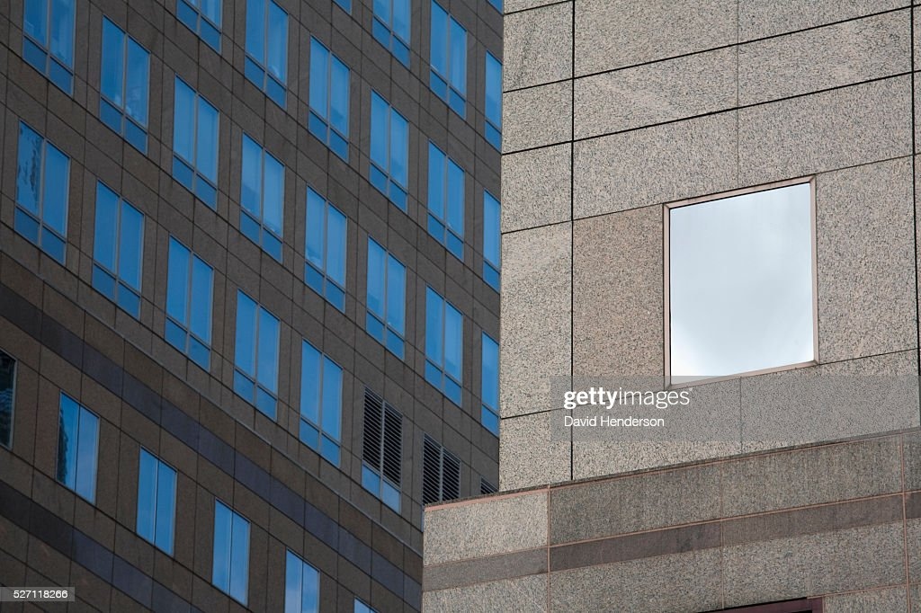 Beige granite skyscraper with glass windows : Stock Photo