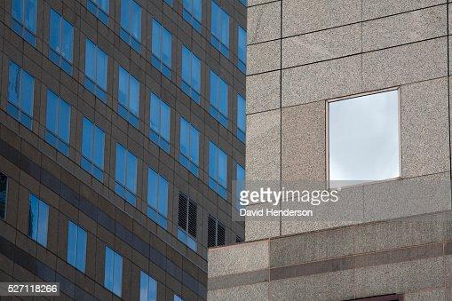 Beige granite skyscraper with glass windows : Stock Photo