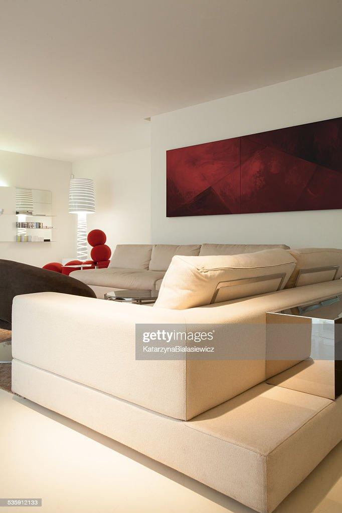 Beige sofa inside designed room : Stock Photo