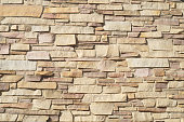 stone wall brick texture background beige surface facade
