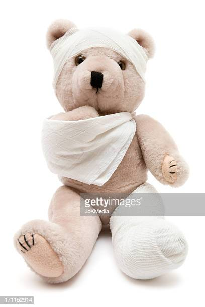Beige teddy bear wrapped in bandages and a cast