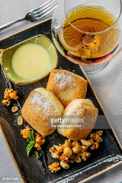 Beignet's with carmel popcorn peanuts and garlic cream sauce at Sheila Johnson's brand new luxury resort hotel on October 2013 in MIddleburg VA
