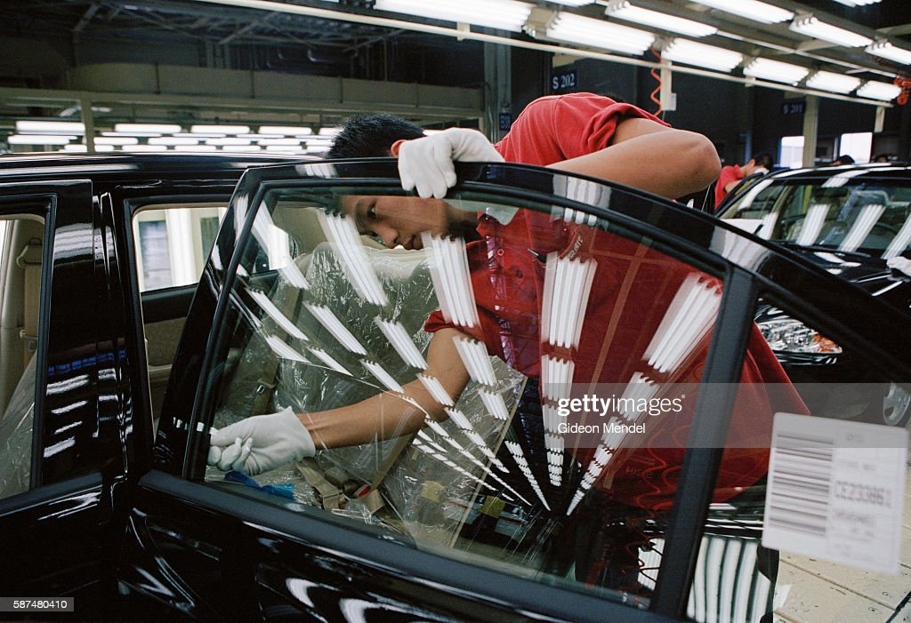 Beijing A City Transforming A final inspection of the completed bodywork as a new car rolls off the production line at the Hyundai factory in Beijing...