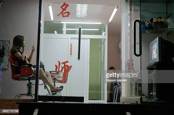 Beijing A City Transforming A hairdresser checks her makeup and watches television as she waits for customers in the Chaoyang district of Beijing The...