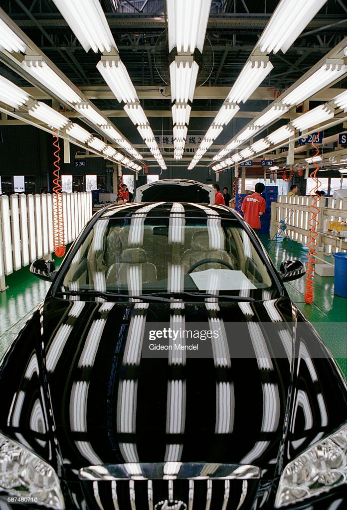 Beijing A City Transforming A new car awaits inspection after rolling off the production line at the Hyundai factory in Beijing Hyundai is a South...