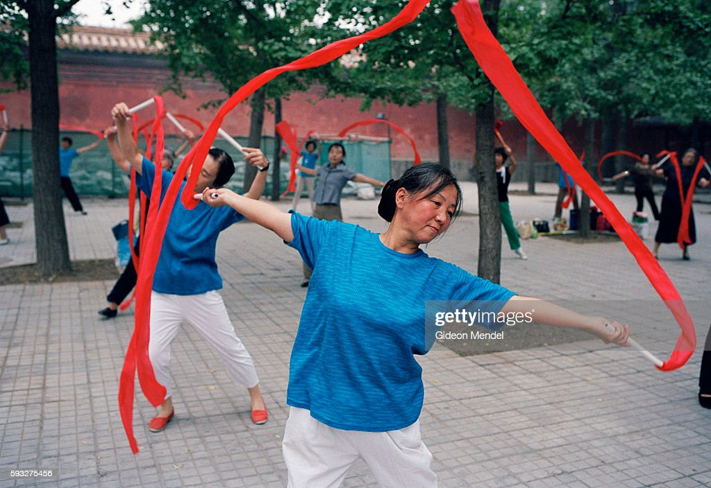 Beijing A City Transforming In Zhongshan Park elderly women dance as a form of morning exercise They meet four times a week to practise a series of...