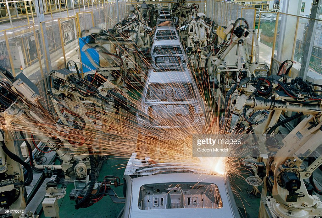 Beijing A City Transforming Sparks fly as robotic arms weld car frames at the Hyundai factory in Beijing Despite the fact that labour is cheap in...