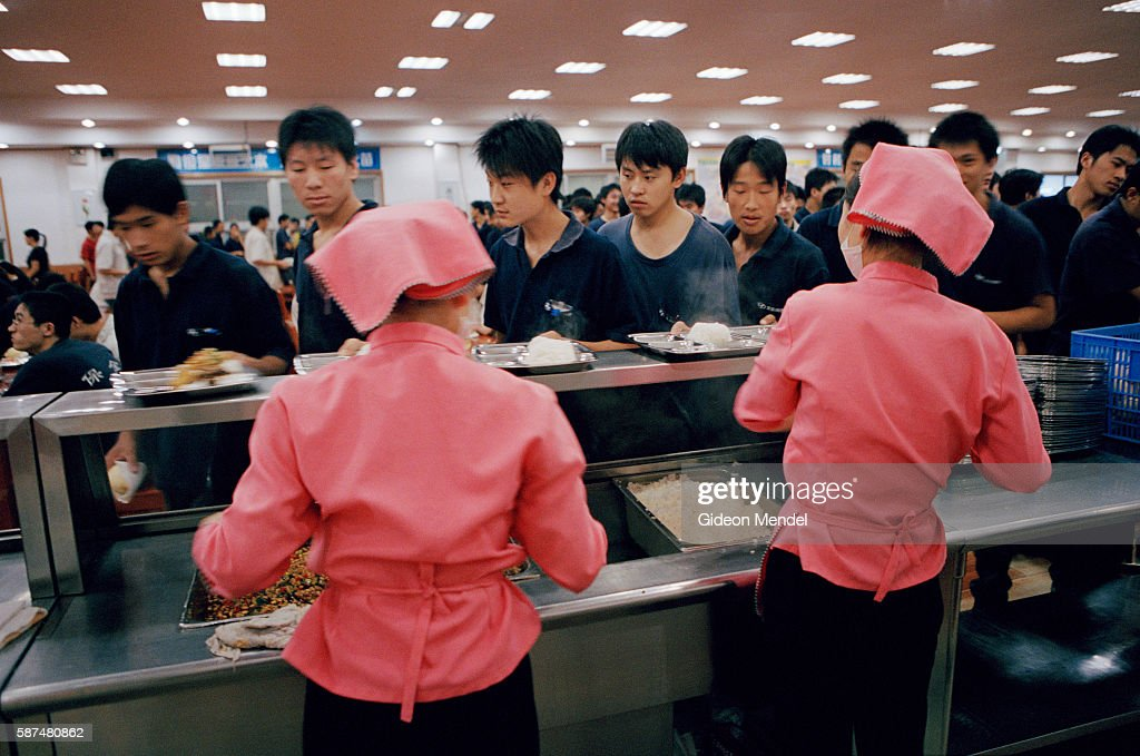 Beijing A City Transforming Workers queue for lunch at the Hyundai factory in Beijing Hyundai is a South Korean company This Beijing factory is a...