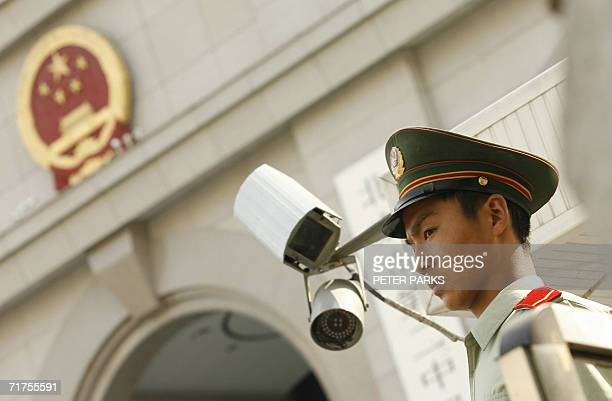 A Chinese paramilitary policeman stands guard outside Beijing's No 2 Intermediate Court where Hong Kong reporter Ching Cheong was sentenced to five...