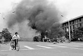 1989 Beijing China A civilian hurries away from Tiananmen Square after its occupation by the Chinese army during the night between the 3rd and 4th...