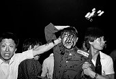 1989 Beijing China A wounded soldier of the Chinese army is rescued by students after his tank was destroyed during the Tiananmen Square massacre...