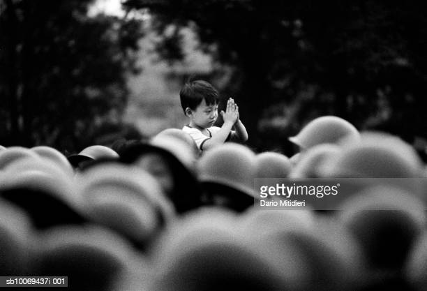 1989 Beijing China A young boy welcomes Chinese soldiers approaching Tiananmen Square just a few hours before the massacre had begun unaware of the...