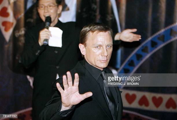 Actor Daniel Craig waves on arrival for the premiere of the latest James Bond film 'Casino Royale' 29 January 2007 in Beijing James Bond made its...