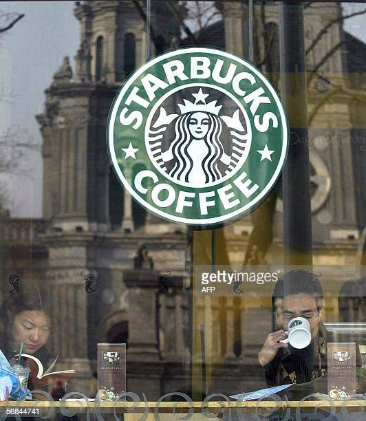Beijing's East Cathedral on Wangfujing Street is reflected in the window of a Starbucks Coffee store in this 09 February 2004 file photo Starbucks...