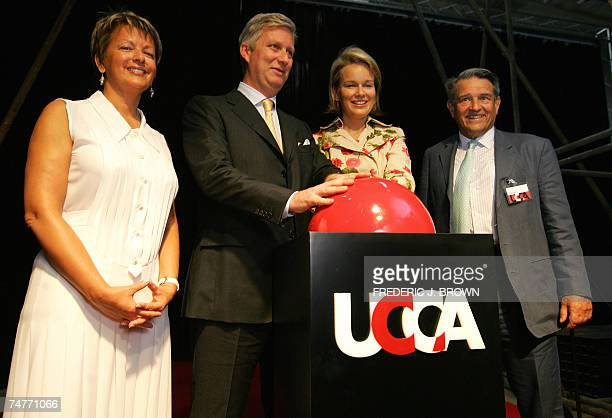 Belgium's Crown Prince Philippe and Crown Princess Mathilde pushes the red button during an unveiling ceremony at construction site of the Ullens...