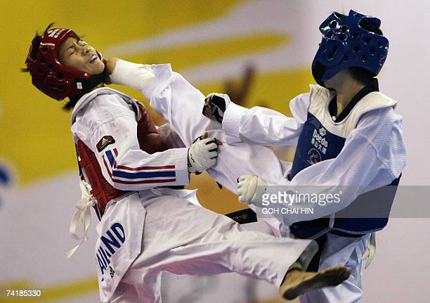 China's Wu Jingyu delivers a kick to the head of Thailand's Yaowapa Boorapolchai during the women's 47kg final in the World Taekwondo Championship in...