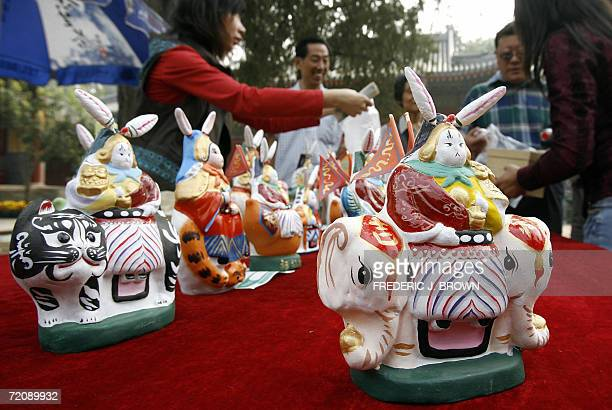 Clay figurine rabbit gods on display for sale at a Taoist temple in Beijing 05 October 2006 in celebration of the midAutum festival on 06 October...