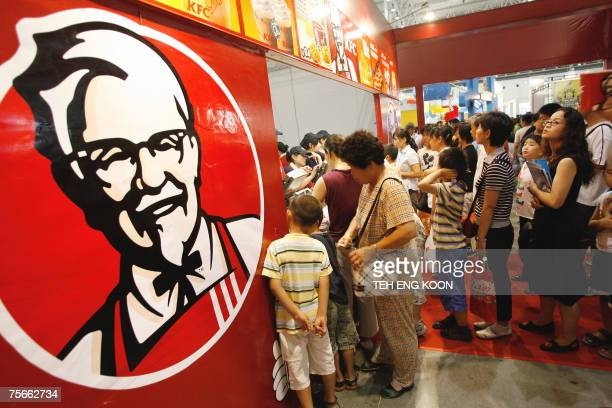 Customers line up to buy Kentucky Fried Chicken in Beijing 26 July 2007 China's economy is set to expand 112 percent this year and become the largest...