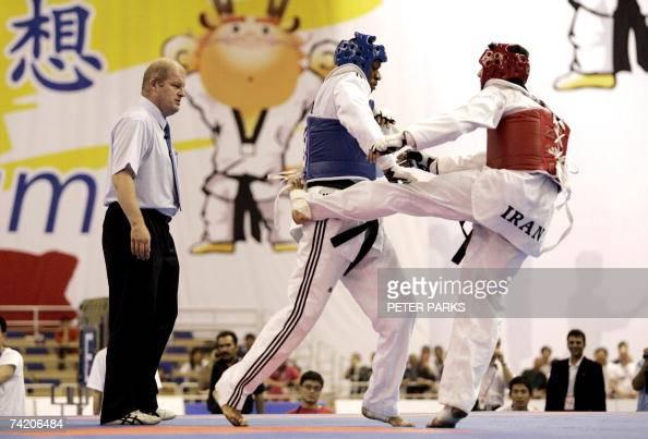 Daba Modibo Keita of Mali clashes with Morteza Rostami of Iran in the Male Heavyweight final in the World Taekwondo Championship in Beijing 21 May...