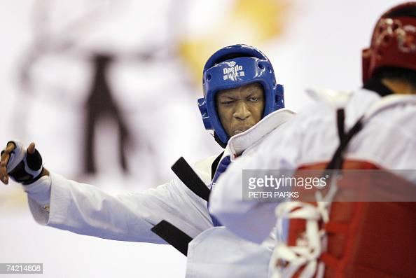 Daba Modibo Keita of Mali clashes with Nam Yunbae of South Korea in the Male Heavyweight semifinal in the World Taekwondo Championship in Beijing 21...