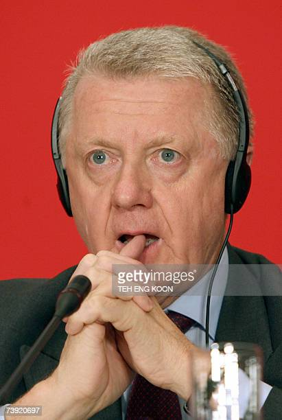 IOC Coordination Commission Chairman Hein Verbruggen reacts as he listens to a reporter question during a press conference in Beijing 19 April 2007...