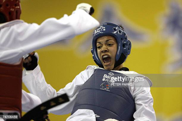 Karine Sergerie of Canada clashes with Park Hyemi of Korea in the Female Lightweight final in the World Taekwondo Championship in Beijing 21 May 2007...