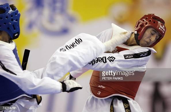 Rafik Zohri of the Netherlands is kicked by Filip Grgic of Croatia in the Male Bantamweight semifinal in the World Taekwondo Championship in Beijing...