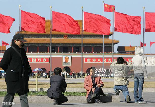 Red flags fly on a windy day on Tiananmen Square in Beijing under heightened security during ongoing sessions of the communist government's annual...