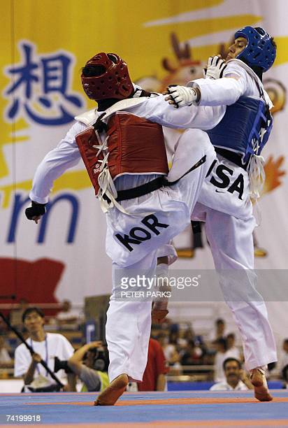 Steven Lopez of the US clashes with Jang Changha of Korea during the mens under 78kg final in the World Taekwondo Championship in Beijing 20 May 2007...