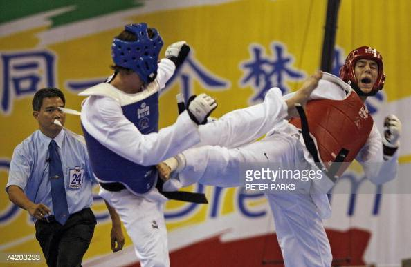 Steven Lopez of the US clashes with Sebastien Michaud of Canada during the men's under 78kg semifinal in the World Taekwondo Championship in Beijing...