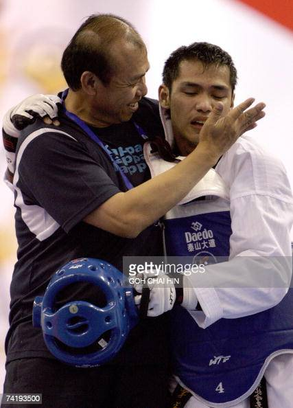 Taiwan's Sung Yu Chi hugs his coach after beating Afghanistan's Nesar Ahmad Bahavee in the men's under 72kg final of the World Taekwondo Championship...