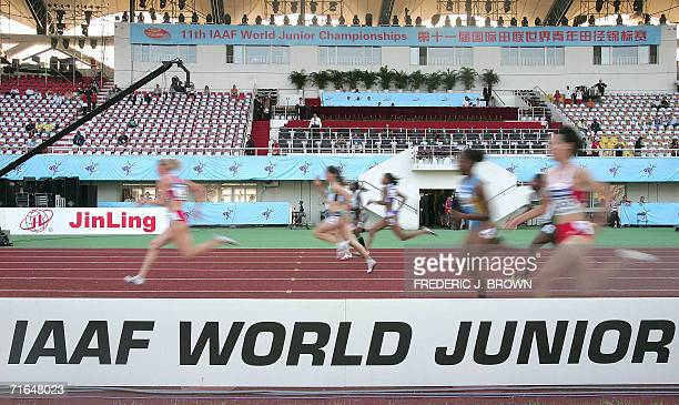 Tezdzhan Naimova of Bulgaria sprints to victory ahead of the pack in a women's 100m semifinal 15 August 2006 in Beijing at the 11th IAAF Track and...