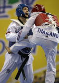 Thailand's Watcharaporn Dongnoi sends a kick towards Turkey's Hamide Bikcin in the women's under 59kg semifinal bout of the World Taekwondo...