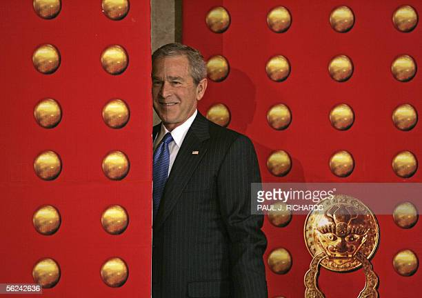 US President George W Bush looks back at reporters following a press briefing on his trip to Beijing China 20 November 2005 at the St Regis Hotel...