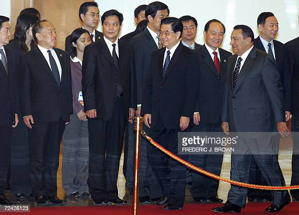 Visiting President of Egypt Hosni Mubarak walks behind Chinese President Hu Jintao while meeting top Chinese leaders ahead of a review of the honour...