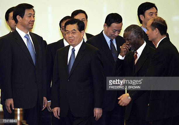 Visiting South African President Thabo Mbeki follows Chinese President Hu Jintao after meeting top Chinese leaders 06 November 2006 on arrival for a...